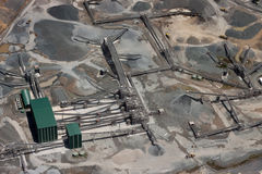 Quarry Aerial View. Aerial view of large working gravel quarry featuring conveyor belts, dump trucks and stockpiles. Focus center of frame royalty free stock photos