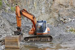 Quarry aggregate with heavy duty machinery. Construction industr. Y. Horizontal Royalty Free Stock Photo
