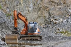 Quarry aggregate with heavy duty machinery. Construction industr. Y. Horizontal Royalty Free Stock Photography