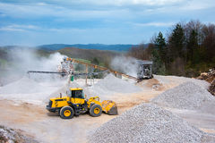 Quarry aggregate with heavy duty machinery Royalty Free Stock Photo