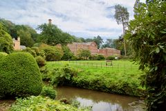 Mill by the water. Quarry bank mill wilmslow Cheshire England united kingdom royalty free stock photography