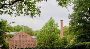 View through the trees. Quarry bank mill wilmslow Cheshire England united kingdom royalty free stock photography