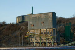 Quarry buildings. Quarry building made of corugated metal with a conveyor belt and steps on the outside Stock Image