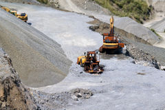 Quarry and bulldozers Royalty Free Stock Images