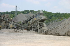 Quarry construction converyors. Construction conveyors with piles of sand, coal and stone royalty free stock images