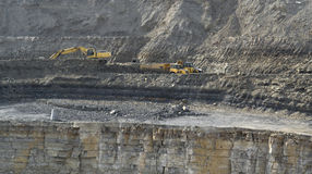 Quarry digger and dump trucks Royalty Free Stock Photo