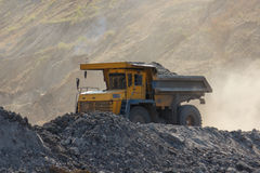 Quarry dumptruck working in a coal mine Stock Images
