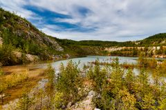 Quarry explored by scuba divers. Flooded quarry for adrenaline hobby. Diver site with fresh blue and clean crystal water with. Divers. Divers in the blue quarry stock images