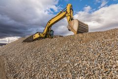 Quarry extracting stone for the construction of a road royalty free stock photo