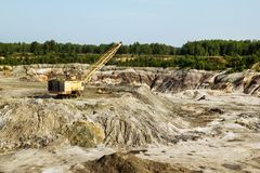 Quarry for the extraction of clay with excavator. stock photos