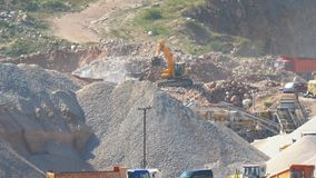 Quarry for the extraction of flux limestone. Work excavator in a quarry for the extraction of flux limestone stock video