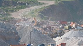 Quarry for the extraction of flux limestone. Work excavator in a quarry for the extraction of flux limestone stock footage