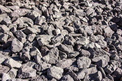 Quarry full of chiseled gray lava rocks, on the hillside. Amazing to look at these countless sharply chiseled lava rocks.. Impossible to walk on, on the hillside royalty free stock photography