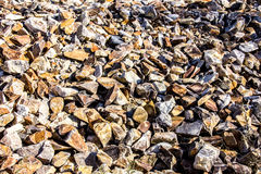 Quarry full of chiseled stones of gray and gold Stock Image