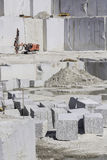 Quarry. Granite quarry in which a machine is working stone grinder stock images