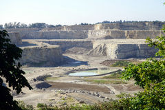 Quarry and lake Stock Photography