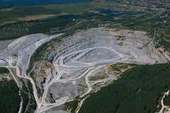 Quarry limestone mining near residential buildings. Stock Photos