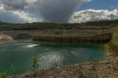 Quarry in Maastricht home to the eagle owl and public park for recreation. Old marl quarry in Maastricht which with a dramatic sky. Which was home to the famous stock photo