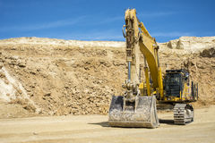 Quarry mine with heavy equipment. Heavy equipment in strip mine quarry in the UK Stock Photos
