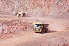 Quarry mine of porphyry rock. dumper truck driving around.  Stock Photo