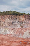 Quarry mine of porphyry rock. earthmover bulldozer driving aroun. D Stock Photography