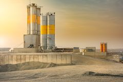 Quarry with silo in an industrial zone stock images