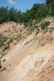 Quarry. Slope of the sand pit in the spring forest Stock Photo