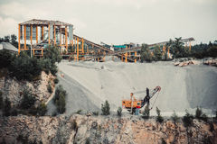 Quarry stone, yellow machine works, Royalty Free Stock Images