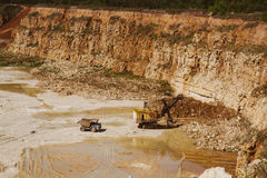 Quarry truck and quarry excavator machine works in limestone mining Stock Photo