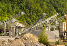 Quarry and vegetation. A picture of a quarry surrounded by trees and vegetation Royalty Free Stock Photos