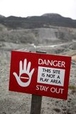 Quarry warning sign. Childrens warning sign at open cast quarry Royalty Free Stock Photo