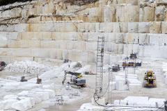 Quarry of white marble. Work in quarry of white marble Royalty Free Stock Photo