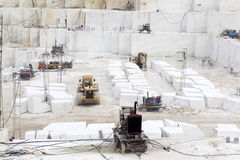 Quarry of white marble. Work in quarry of white marble Royalty Free Stock Images