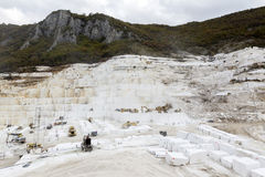 Quarry of white marble. Work in quarry of white marble Royalty Free Stock Photos