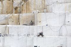 Quarry of white marble. Work in quarry of white marble Stock Photography