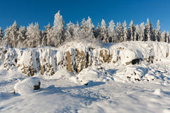 Quarry. Winter snow covers the rocks of a quarry Royalty Free Stock Photography