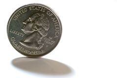 Quarter. A US quarter casting a shadow on a white background Stock Photo