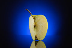Quarter apple on dark blue background Royalty Free Stock Photos