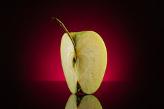 Quarter apple on dark red background Stock Photo