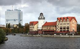 Quarter of buildings in German style on the river bank Royalty Free Stock Photos