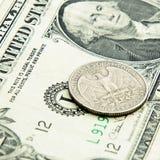 Quarter dollar. And dollar closeup Royalty Free Stock Photos