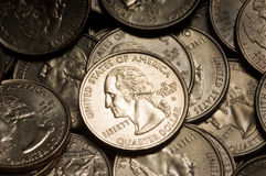 Quarter Dollar Coins. Pile of American Quarter Dollar Coins. Lighting & focus centered on middle coin royalty free stock photo