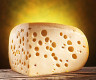 Quarter of Emmental cheese head. Royalty Free Stock Photo