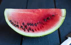 Quarter juicy, sweet slices of watermelon. Freshness on the board Royalty Free Stock Photo