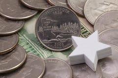 A quarter of Minnesota, quarters of USA and white star. stock photos