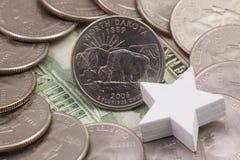 A quarter of North Dakota , quarters of USA and white star. Stock Photos