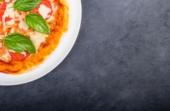 Quarter of pizza on the plate royalty free stock photos