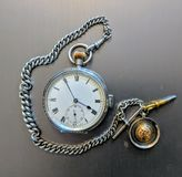 Quarter reapeater pocket watch and chain Stock Photo