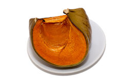 A quarter of a ripe pumpkin on a plate Royalty Free Stock Photos