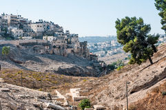 Quarter of Silwan in East Jerusalem. Field of blood in the backg Stock Images